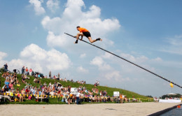 Dutch Vaulter crossing the water in the Dutch Vaulting sport called Fierljeppen,. Unlike Pole Vaulting which rewards heigth, Fierljeppen rewards distance.