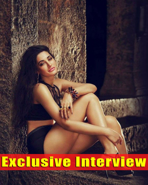 Nargis Fakhri who has grooved with Salman Khan on the song Devil in his upcoming film Kick talks about her experience working with the star in an exclusive chat with Biscoot Showtym.