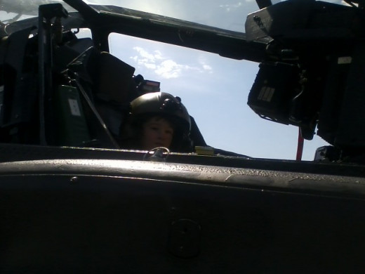 "Army Day. Climbed into the helicopter. Rachel said to the soldier, ""Where are the keys?""."