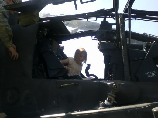 Hannah, age seven, sitting in the helicopter.
