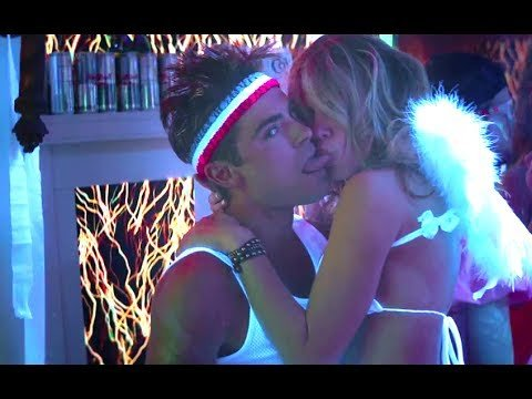 Party scene from the movie, The Neighbors. Might our grandchildren look at this and wonder what were we thinking?