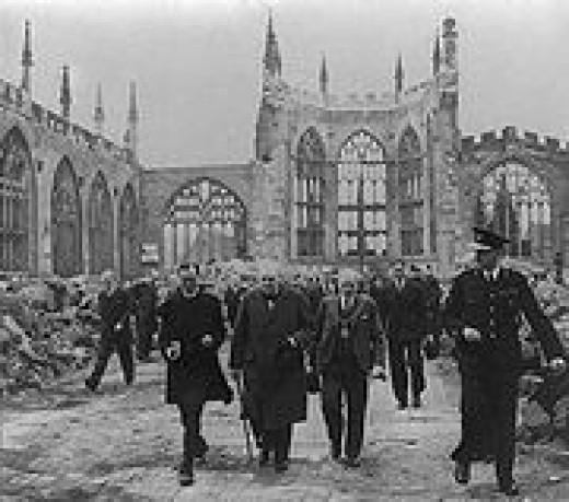 Churchill walking through the ruins of Coventry Cathedral after heavy bombing nearly levelled the city.