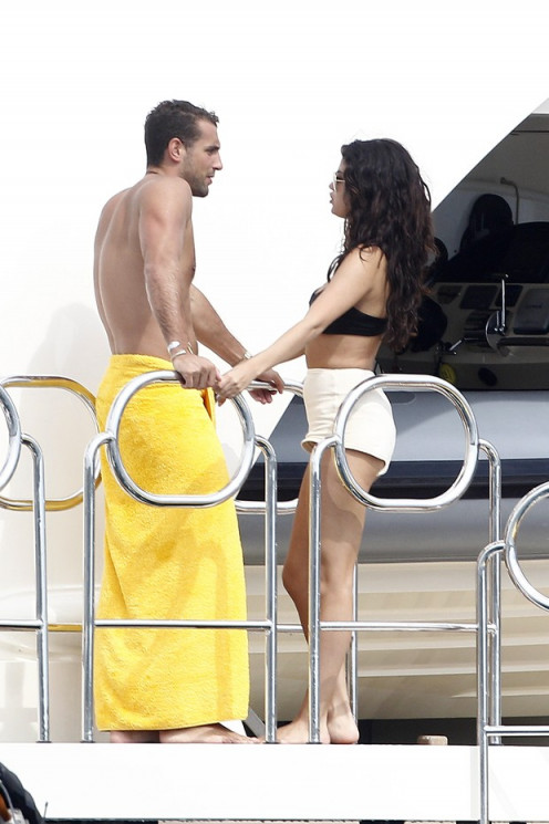 Selena chatting it up with tommy chiabra while on her birthday celebration in Italy.