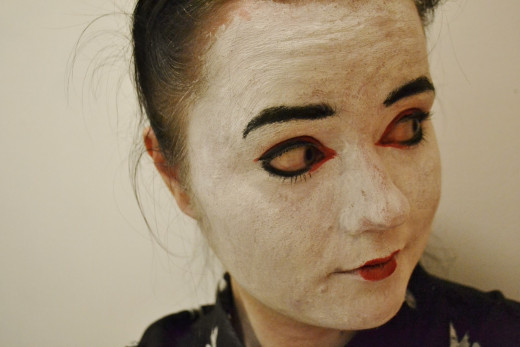 Paint your face white and apply eyeliner