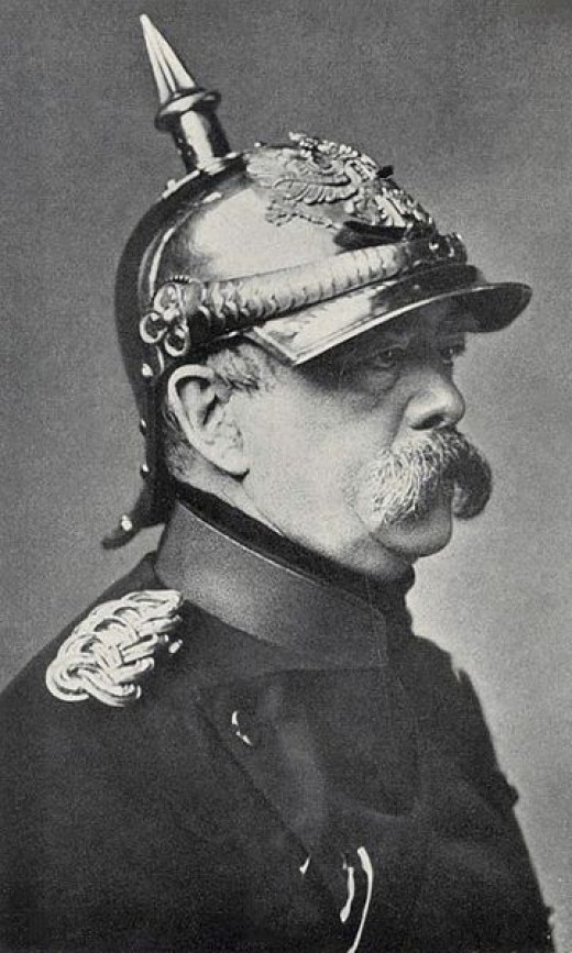 The Prussian spiked helmet, or Pickelhaube was designed in 1842 by King Frederich Wilhelm IV of Prussia. It was made of boiled leather with a metal trim. Incidentally the man under the helmet is Otto von Bismarck.