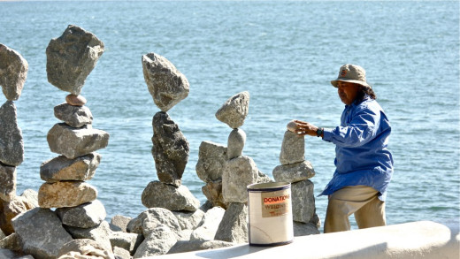 Rabinda Sakar balances rocks in Seaport Village, San Diego, CA