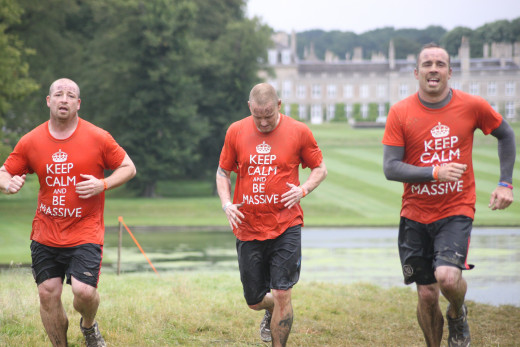 Runners in action at Broughton House, Kettering. Tough Mudder Midlands 2014