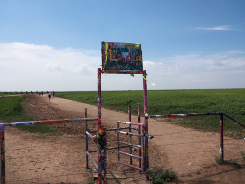The sign at the gate to Cadillac Ranch has completely changed .