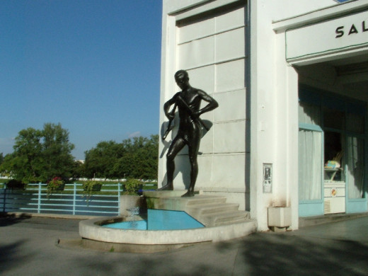 "The statue of ""A man breaking a crutch"" in the spa town Piestany (Slovakia).  A spa town is called a bathing-place, situated around a mineral spring. The word comes from the Belgian town Spa."