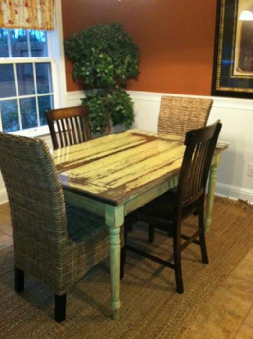 This old door, bought at a salvage yard was re-purposed into beautiful dining table