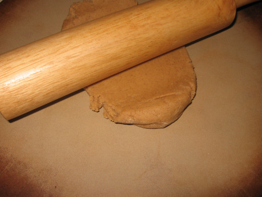 6. If you are not going to make the crackers right away, you can keep the dough in the fridge until you are ready to roll it out.  However, if you are ready then you do not need to do this step.  Use a rolling pin to roll out half the dough.  Repeat
