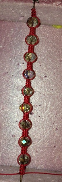 Continue adding a series of beads and knots until you have used all 9 beads.