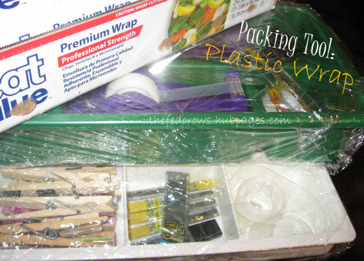 Genius!  Use plastic wrap to keep the organizers you already use organized!  Perfect for emptying out desk drawers.