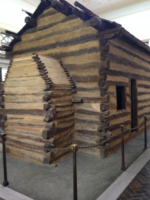 RECREATION OF LINCOLN'S CABIN WHEN HE WAS A BABY, LOCATED IN LINCOLN MEMORIAL - SIDE VIEW