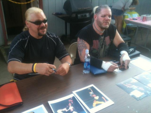 Shane Douglas and Raven sign autographs at an independent pro wrestling fundraiser event.