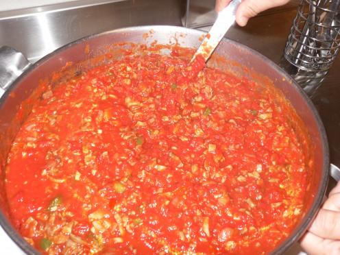 Tomato Sauce on the stove cooking.  To be  added to your mock cabbage rolls.