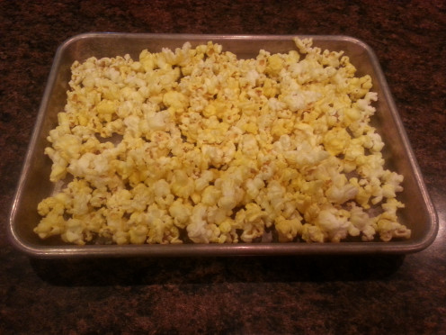 * Don't pour your popcorn out onto the cookie sheet, remember, we don't want the uncooked kernels!  Throw away uncooked kernels.