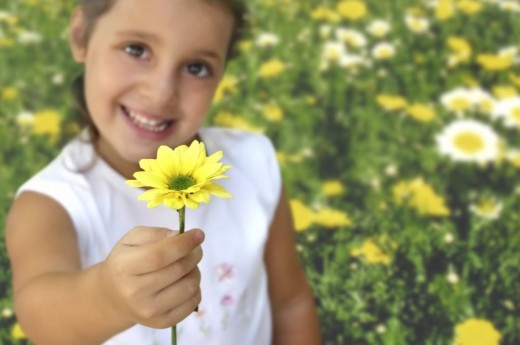 A young girl with yellow flower