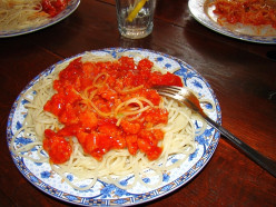 Cooked Spaghetti Pasta and Homemade Sauce served on a plate. Ready to be served to family and friends.