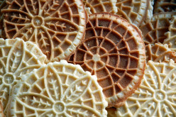 This is a group of different kinds and flavors of pizzelles. The dark colored ones could be chocolate flavor ones or the light color ones can be the common anise or maybe vanilla flavor ones. Try to make some of these different ones and enjoy them.