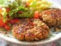 Pumkin-seed crusted lentil patties with roasted garlic mashed potato and salad