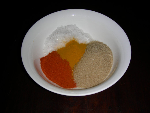 Salt, Sugar, Chili Powder and Turmeric.  Salt, Sugar and Turmeric powder are home remedies but not chili powder.