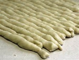 Dough ropes ready to cut into croutons.