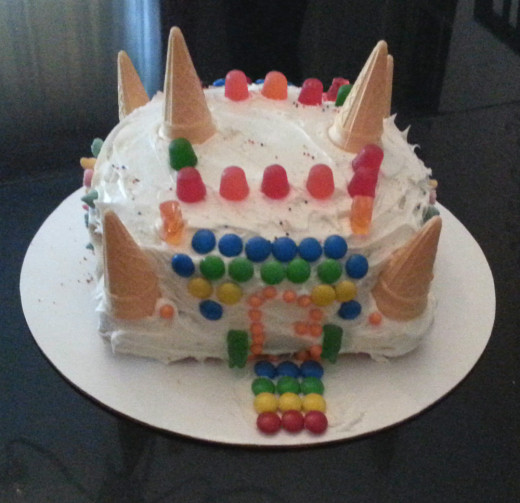The candy castle cake is easily decorated with candy and ice cream cones.