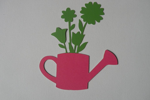 Adhere Pink cardstock watering can to large green