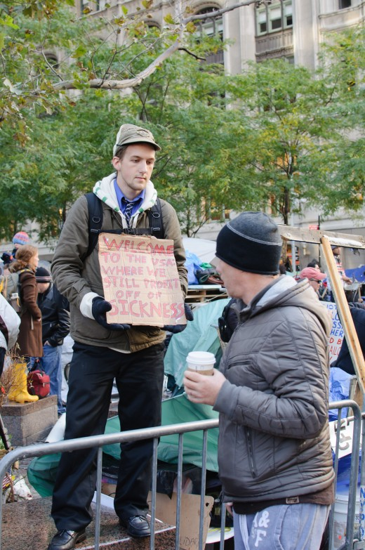 "The ""Occupy Wall Street"" protest began on 17 September 2011 at Zuccotti Park in Lower Manhattan, near Wall Street, which the protesters renamed as ""Liberty Square."" Many people throughout the US and beyond have been upset by an economic system that b"