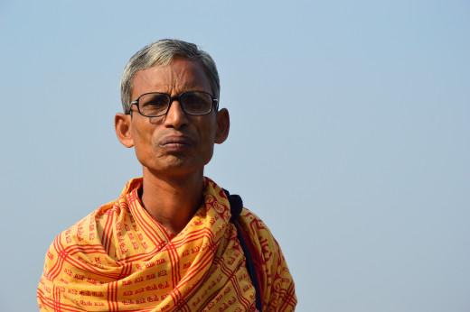 A Hindu Priest  at Ram Chandra Goenka Zenana Bathing Ghat - Kolkata,  West Bengal on Mahalaya, the last day of Shraddh Paksh.