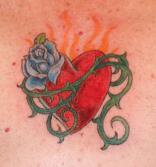 Another heart tattoo but this is the normal heart shaped that people are used to.