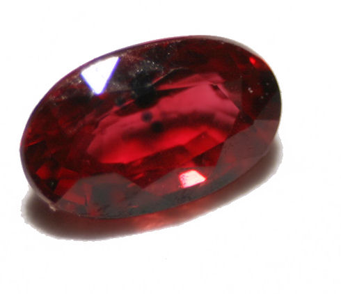 Oval cut ruby gemstone with inclusions. This stone is transparent and has beautiful color. However, inclusions are visible.