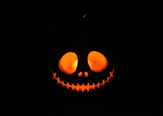 A grinning Jack O'Lantern is a traditional design. This one is particularly stunning. One of the best carved pumpkins I've seen in the traditional designs!