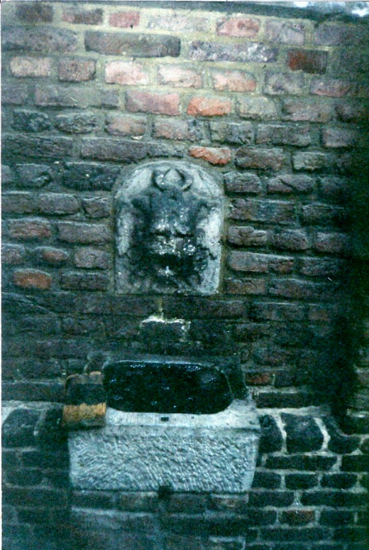 Monstrous Water Fountainhead In Castle In Belgium