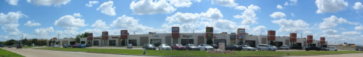 Composite photo of a block-long strip mall