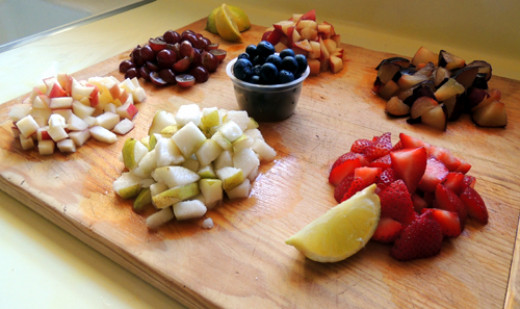 prep your fruits. Dice into 1 inch cubes (strawberries, but not berry-berries...or even Lionel Barry)