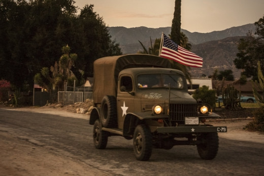 This is a perfect example of a snapshot. Its 4th of July and an old army truck goes by. I can't replicate it only make the best of what I captured in the moment.