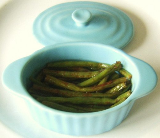 Green beans with cumin can be served in a warmed serving dish with a lid to keep them nice and hot for longer