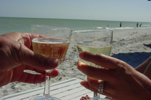 Jeff Klisares couple having adrink on the beach.