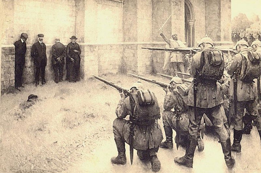 German soldiers executing Belgian civilians during the early stages of their occupation of the country in 1914.