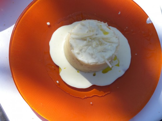Divine - egg yolk inside mashed potatoe with white sauce and cheese