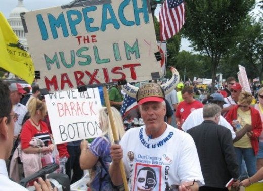 "The photo is titled: ""Tea party crazy,"" an insult for a photo of people rallying round insults of the president."