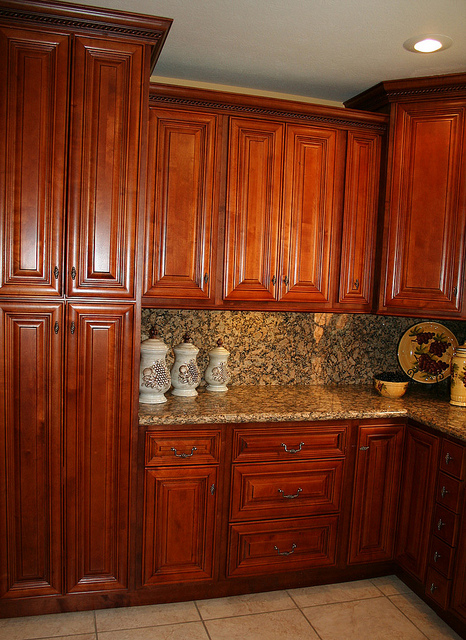Cherry kitchen cabinets with a light stain.