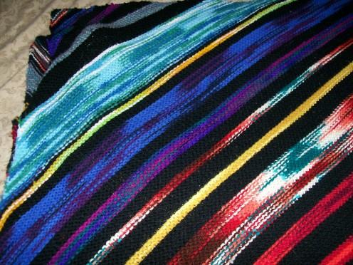 Stripes of ombre yarn separated by stripes of black yarn. It makes the colors pop.