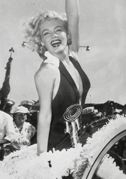 Marilyn Monroe at the 1952 Miss American Pageant to which she was the Grand Marshall. Her scandalously low neckline to the event was the subject of much discussion.