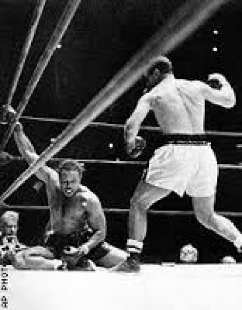 Rocky Marciano knocked out Archie Moore in the ninth round in defense of his heavyweight championship.,