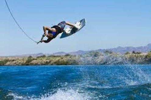 Wakeboarders like to do tricks and getting as much air as possible is a goal of the top performers in this sport. Practice makes perfect they say.