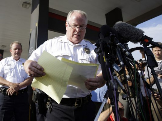 Reporters gathering information from Ferguson Police Chief Thomas Jackson.