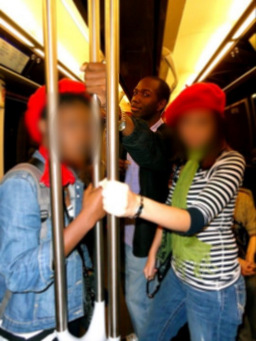 Riding the French Metro and wearing stereotypical red berets
